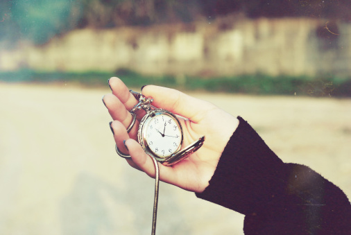 Pocket watch in hands
